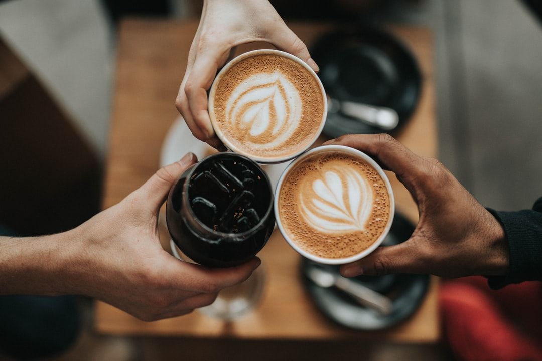 A person holding a cup of coffee